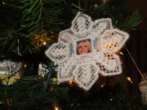 An ornament made by my  mother with a photo of my daughter